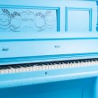 Colorful blue upright piano — Stock Photo #63613095