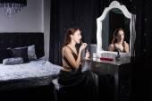 Glamorous young woman applying makeup — Stock Photo