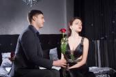 Gentleman Giving Rose Flower to Mad Girlfriend — Stock Photo