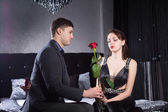 Young Man Offering Rose Flower to Sad Girlfriend — Stock Photo