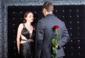 Man Talking to a Lady with Rose on his Back — Stock Photo