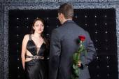 Man with Rose Behind his Back Talking to his Girl — Stock Photo
