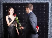 Young Man Giving a Rose to his Girlfriend — Stock Photo