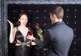 Boyfriend Offering a Ring and Rose to Girlfriend — Stock Photo