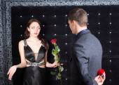 Young Man Offering a Flower to Unhappy Lady — Stock Photo