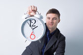 Young Businessman Holding Alarm Clock — Stock Photo