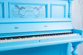Colorful blue upright piano — Stock Photo
