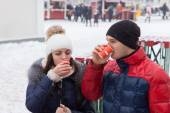 Young couple sipping hot drinks on a cold day — Stock Photo