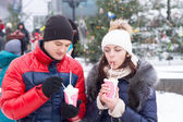 Young Sweethearts with Winter Cup Drinks — Stockfoto