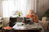 Serious Old Man Reading News on Tabloids — Stock Photo