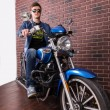 Handsome Guy Sitting on a Blue Sports Motorbike — Stock Photo #67830927