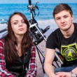 Постер, плакат: Young Lovers at the Tranquil Beach with Motorcycle