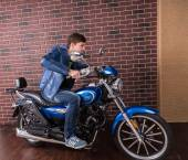 Young Man in Blue Jacket on his Sports Motorbike — Stock Photo