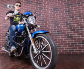 Young Man Sitting on Classic Blue Motorcycle — Stock Photo