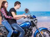 Couple Riding a Motorbike with Beach Background — Stock Photo