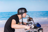 Man Riding a Motorcycle at the Beach with Helmet — Stock Photo