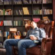 Young man dozing off in a public library — Stock Photo #68607205