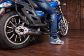 Man parking his motorbike — Stock Photo