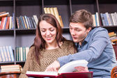 Happy Young Couple Enjoy Reading a Book — Stock Photo