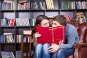 Couple Behind a Book Looking Each Other So Closed — Stock Photo