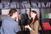 Couple Deciding What Book to Read at Library — Stock Photo