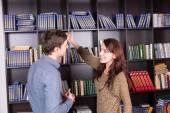 Happy Young Couple at Library Looking Each Other — Stock Photo
