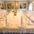 Elegant wedding table in a classic dining room — Stock Photo #69250657