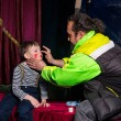 Man Applying Clown Make Up to Boys Face — Stock Photo #72162971