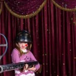 Girl Wearing Helmet Holding Large Gun on Stage — Stock Photo #72163913