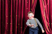 Happy little boy actor making his entrance — Stock Photo