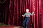 Exuberant little boy performing on stage — Stock Photo
