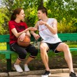 Young Athletic Couple Having Conversation on Bench — Stock Photo #73876685