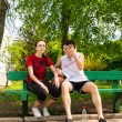 Young Couple Sitting on Park Bench with Basketball — Stock Photo #73876671