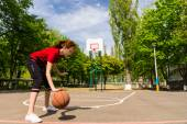 Athletic Woman Dribbling Basketball at Mid Court — Stock Photo