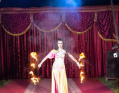 Exotic Fire Dancer Twirling Flaming Batons — Stock Photo