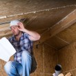 Builder Reading Plans Inside Unfinished Home — Stock Photo #74801539
