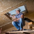 Builder Inspecting Skylight in Unfinished House — Stockfoto #74801585