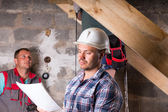 Foreman with Plans Monitoring Work on Staircase — Stock Photo
