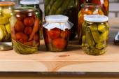 Jars of Pickled Vegetables on Wooden Table — Stock Photo