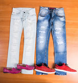 His and Hers Blue Jeans Laid with Shoes — Stock Photo