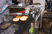 Burger Buns Toasting on Upper Rack of Grill — Stockfoto