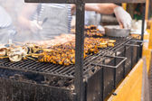 People Cooking Kebabs on Smoking Grill — Stock Photo