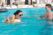 Young Couple Playing with Beach Ball in the Pool — Stock Photo
