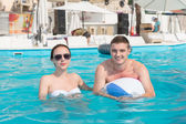 Couple in the Swimming Pool Smiling at the Camera — Stock Photo