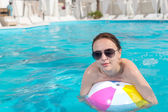 Pretty Woman with Beach Ball in the Pool — Stock Photo