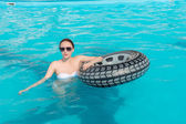 Pretty Young Woman with Lifebuoy in the Pool — Stock Photo
