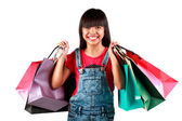 Little asian girl with colorful shopping bags — Stock Photo