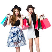 Beautiful asian teen girls carrying shopping bags — Stock Photo