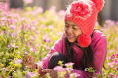 Little asian girl with flower fields — Stock Photo