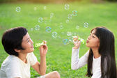 Blowing soap bubbles — Stock Photo
